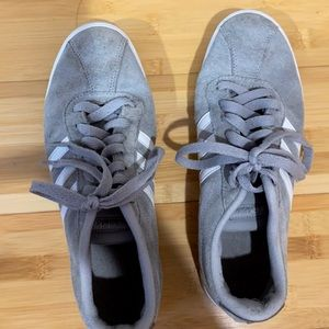 Gray adidas court shoes